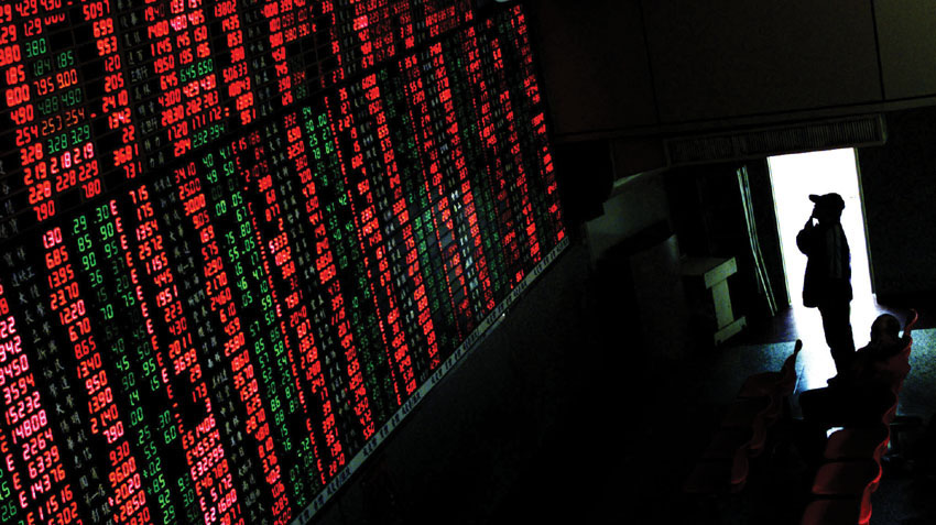 A Taiwan stock investor watches the monitor displaying stock prices in Taipei January 18, 2001. The last trading day before the Chinese New Year, Taiwan stock exchange closes 77.96 points higher, or 1.35 percent to 5847.91. The Chinese New Year of the Snake falls on January 24. Reuters/Kenny Wu